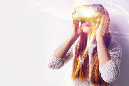 A young beautiful woman in glasses of virtual reality saw something amazing. Modern technologies.