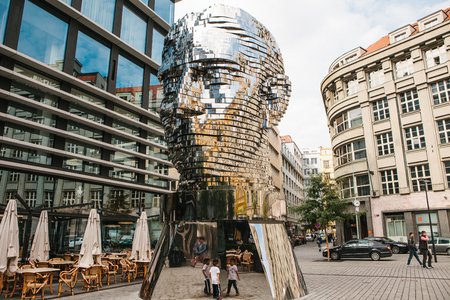 Prague, September 23, 2017: The sculpture of Franz Kafka stands near the shopping center called Quadrio above the metro station, which is called Narodni Trida