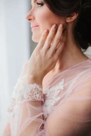 Young woman in a beautiful boudoir. Morning of the bride. Stock Photo