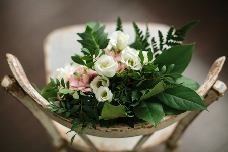 Wedding composition with flowers and a chair.