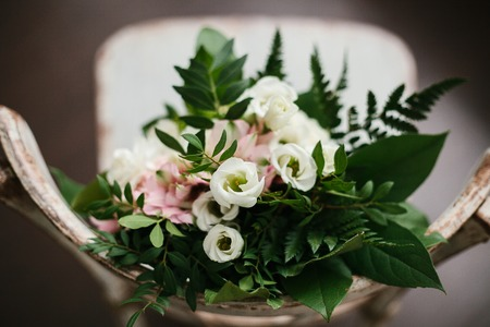 Wedding composition with flowers and a chair. Happy event. Stock Photo