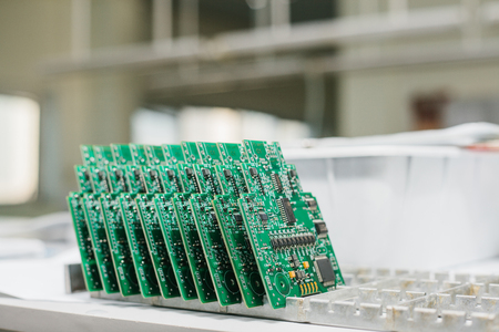 Computer boards stand in a row at the factory for the production of spare parts.