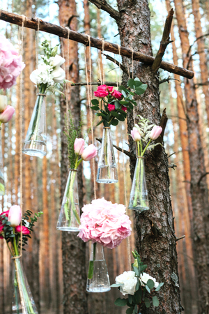 Wedding flowers decoration arch in the forest. The idea of a wedding flower decoration. Stock fotó