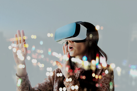 The woman with glasses of virtual reality. Future technology concept. Modern imaging technology.