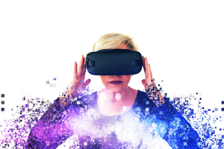 An elderly woman in virtual reality glasses is scattered by pixels. Conceptual photography with visual effects with an elderly person using modern technology. Stock Photo