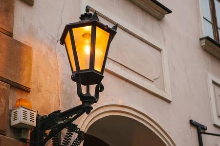 Old vintage lantern on the wall. Street lighting 免版税图像
