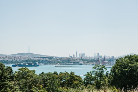 View of the industrial part of Istanbul. Ships, docks and modern cityscape and Bosphorus