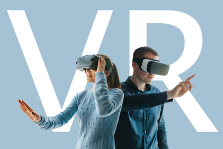 A young man and a young woman in glasses of virtual reality. The concept of modern technologies and technologies of the future. VR glasses