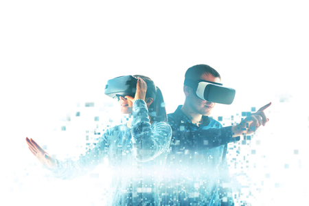 A young woman and a young man in virtual reality glasses are fragmented into pixels.The concept of modern technologies and technologies of the future. VR glasses.