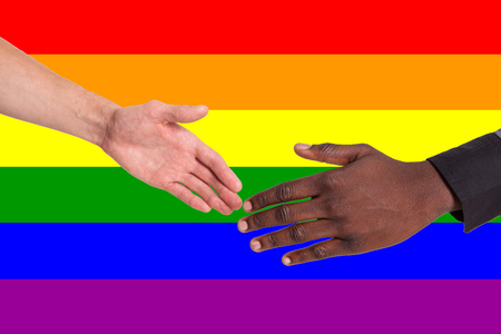 People of different nationalities serve each other against the background of the LGBT flag. The concept of assistance, support, freedom of human rights