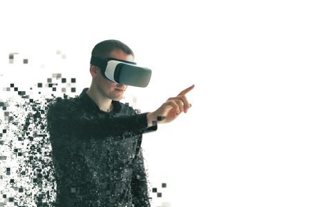 A person in virtual reality glasses is fragmented into pixels. The concept of modern technologies and technologies of the future. VR glasses