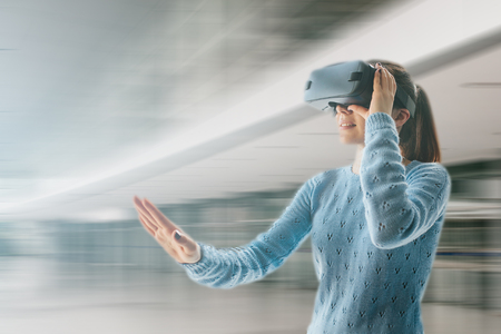 Young woman with virtual reality glasses. Technology of the present and the future Stock Photo