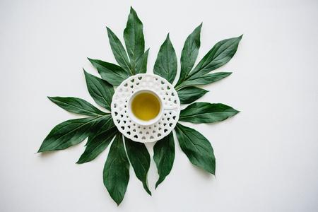 Fresh fragrant and healthy herbal or green tea in a mug. Tea time