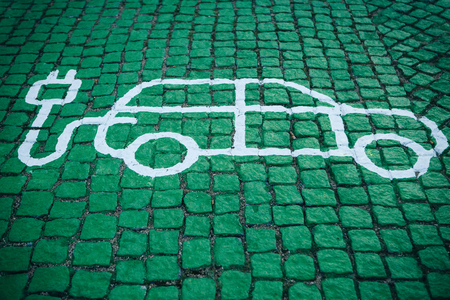 A special place for charging electric cars or vehicles. A modern and eco-friendly mode of transport that has become widespread in Europe. Stockfoto