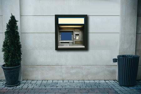 Modern street ATM machine for withdrawal of money and other financial transactions.