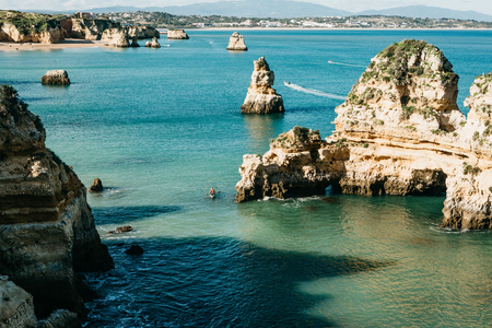 Beautiful views of the Atlantic Ocean and the rocks off the coast of Portugal next to the city called Lagos. Amazing natural landscape. Foto de archivo