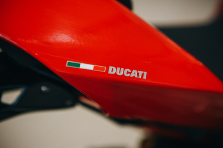 Berlin, August 29, 2018: Close-up. Emblem of Dukati on a sport red motorcycle. The world-famous Italian company producing sports motorcycles.