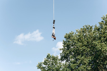 Person jumped with a rope for pleasure and adrenaline. Bungee Jumping. Active sport.