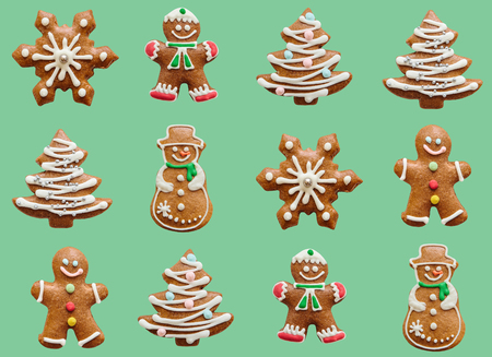 Christmas or winter background. Different ginger biscuits or gingerbread cookies in a row. Imagens