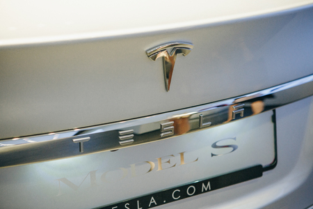 Berlin, August 29, 2018: Closeup of a Tesla sign. An electric vehicle Tesla S at the motor show in Berlin. A modern electric car.