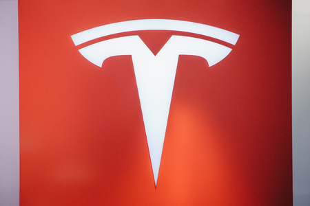 Berlin, August 29, 2018: Closeup of a Tesla sign at the Tesla motor show in Berlin. A modern electric car. Editorial