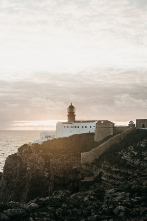 View of the lighthouse and cliffs at Cape St. Vincent in Portugal at sunset. The most south-western point of Europe.