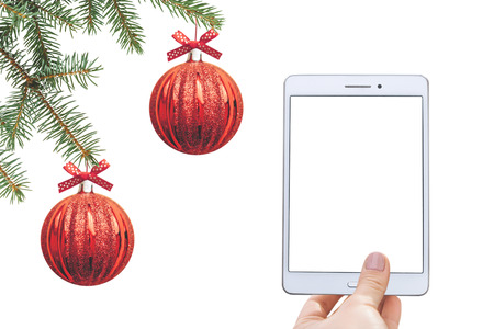 Christmas online sale. Tablet for buying gifts online. Tablet with an empty white screen on the background of Christmas decorations.