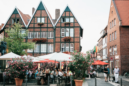 Germany, Muenster, September 25, 2018: Street Cafe. People eat drink and communicate with each other