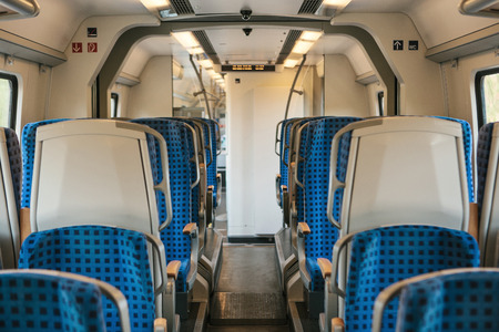 Empty train interior in Germany for moving people for long and short distations. Corridor and a lot of seats.