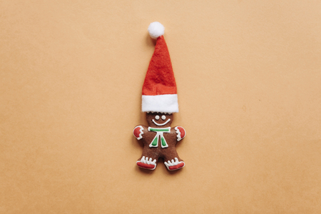 Christmas gingerbread in the form of a small ginger man in a red hat.