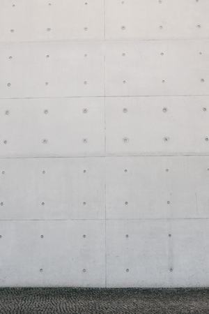 Empty concrete white or gray outer wall and sidewalk. Imagens