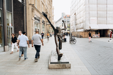 Germany, Leipzig, September 6, 2018: The statue is called Step of the Century on the street of Leipzig.
