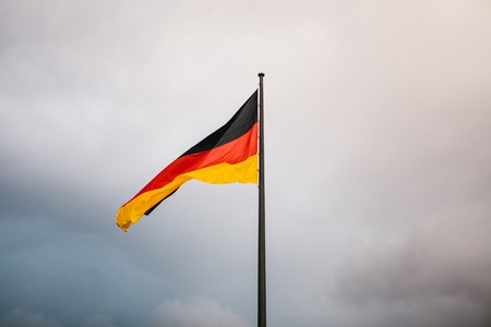 German national flag in the wind against the sky
