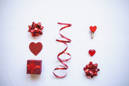 Flat lay various holiday objects including a box with a gift, heart and other things for Valentines Day and Womens Day or Wedding. Festive concept. Stock Photo