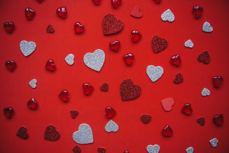 Festive background with many hearts for Valentines Day or another holiday or love event.
