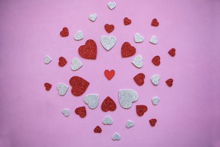 Pattern of many hearts on a pink background. Stock Photo
