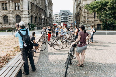 Germany, Leipzig, September 6, 2018: A group of tourists riding bikes sightseeing. Excursion on the bike