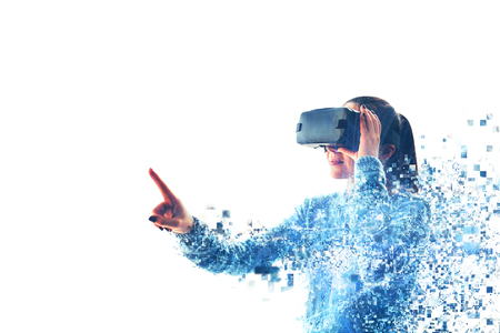 The woman with glasses of virtual reality. Future technology concept. Modern imaging technology. Fragmented by pixels. VR glasses. Foto de archivo