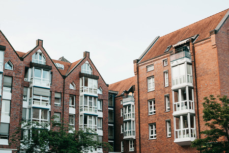 Residential buildings in Muenster in Germany. Ordinary houses in urban area. Apartment buildings in a row. Imagens