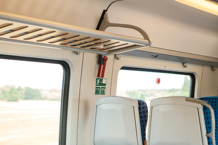 Emergency hammer for emergency breakage of glass and exit in a modern German commuter train. Elements of the interior of the train.
