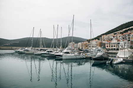Beautiful view of the yachts in the port and urban architecture in Lustica Bay in Montenegro.