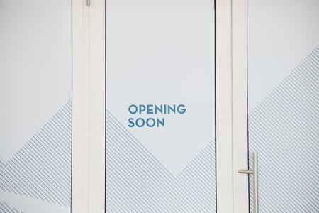 The inscription on the door - opening soon. Stock Photo