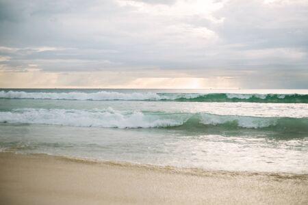 Beach or beach by the sea or ocean at sunset. Natural landscape. Summer season