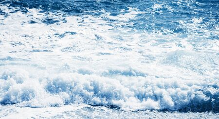 View of the blue sea or ocean with foam and waves background.
