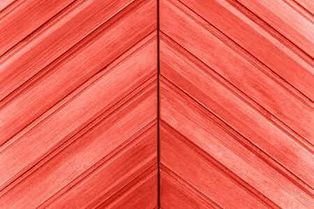 Wooden surface or close-up closed door in trendy living coral color