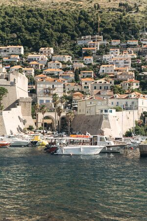 Beautiful view of traditional old buildings and boats in the old town in Dubrovnik in Croatia. Фото со стока
