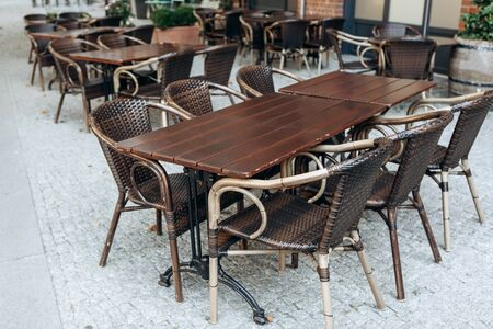 Empty tables and chairs of a street cafe