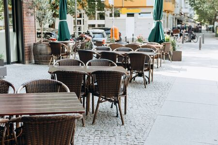 Empty tables and chairs of a street cafe in Berlin in Germany 스톡 콘텐츠