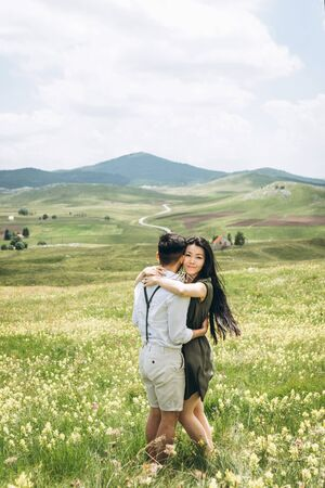 Portrait of a beautiful young adult girl hugging a man 写真素材