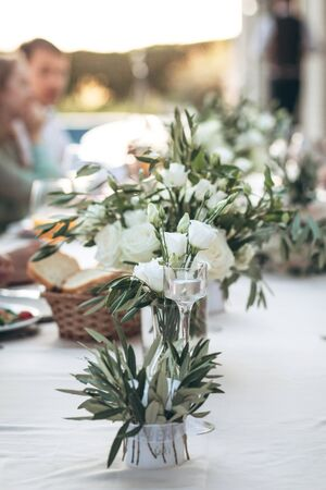 Flowers in a vase on the table as a decoration. Event or celebration.